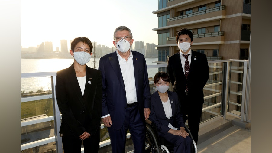 IOC President Thomas Bach meets with Ai Ueda on visit to the Village in Tokyo
