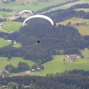 Athletes paragliding in Kitzbühel